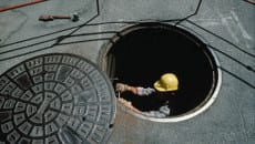 Above View of a Man in a Manhole