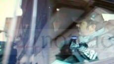 Armando Cusani nell'auto dei carabinieri